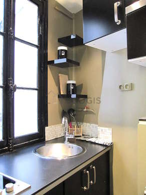 Kitchen equipped with washing machine, refrigerator, crockery