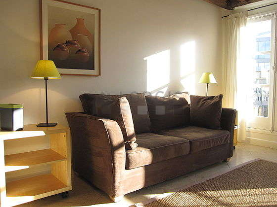 Quiet living room furnished with 1 sofabed(s) of 140cm, tv, 2 chair(s)