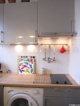 Bright kitchen with double-glazed windows and balcony