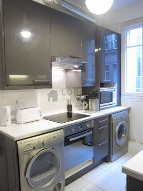 Kitchen where you can have dinner for 3 person(s) equipped with washing machine, dryer, refrigerator, extractor hood