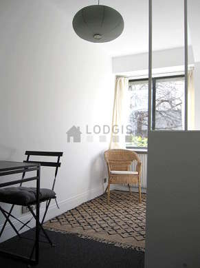 Very quiet living room furnished with 1 bed(s) of 130cm, tv, 1 armchair(s), 2 chair(s)
