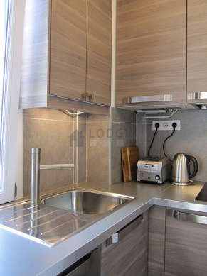 Kitchen equipped with dishwasher, hob, refrigerator, freezer