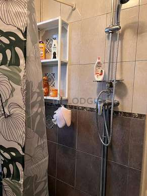 Bathroom with double-glazed windows and with tile floor