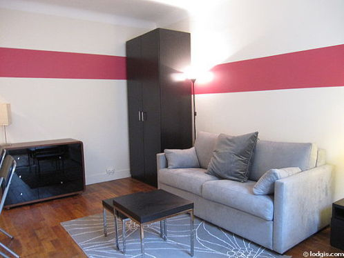 Living room furnished with 1 sofabed(s) of 140cm, dining table, coffee table, wardrobe