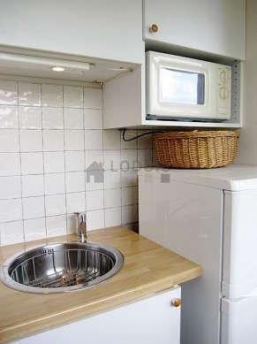 Bright kitchen with windows facing the garden