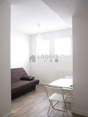 Quiet living room furnished with 1 sofabed(s), dining table, closet, cupboard