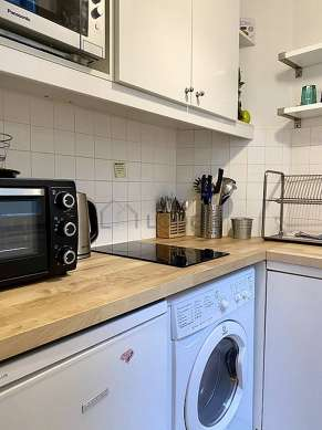 Kitchen equipped with washing machine, dryer, refrigerator, cookware