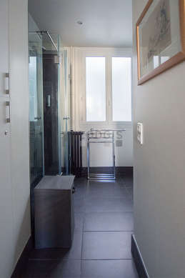 Bright bathroom with double-glazed windows and with tile floor