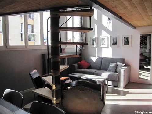 Living room with double-glazed windows facing the road