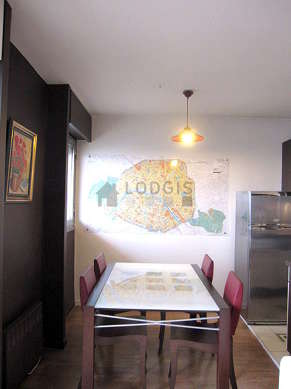Kitchen equipped with dishwasher, hob, refrigerator, cookware