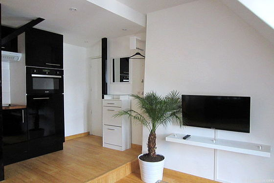 Quiet living room furnished with tv, 2 armchair(s)