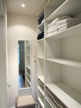 Very quiet and clair walk-in closet with wooden floor