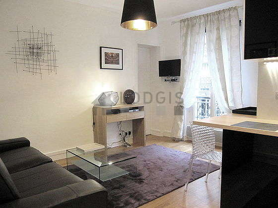 Quiet living room furnished with tv, 2 chair(s)