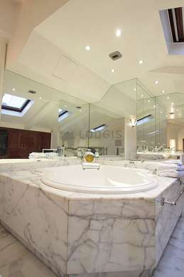 Pleasant bathroom with double-glazed windows and with marble floor