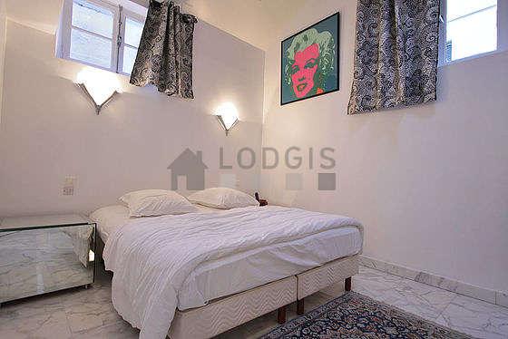 Bedroom with marble floor