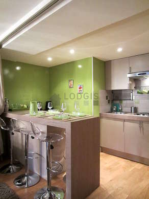 Kitchen where you can have dinner for 4 person(s) equipped with hob, refrigerator, freezer, extractor hood