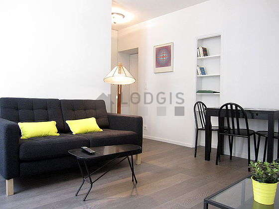 Quiet living room furnished with tv, 3 chair(s)