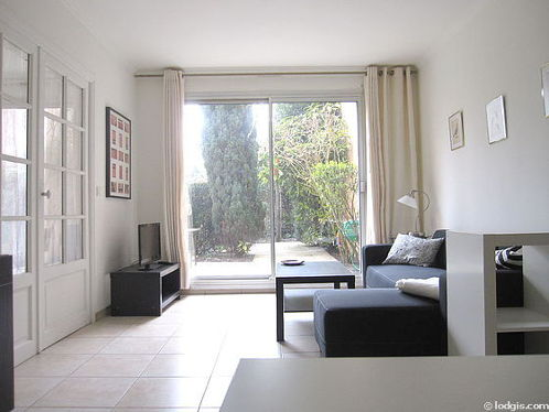Living room with double-glazed windows facing the garden
