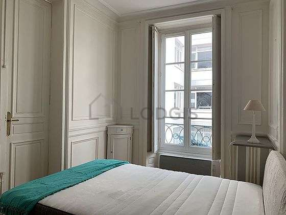 Bright bedroom equipped with closet, bedside table