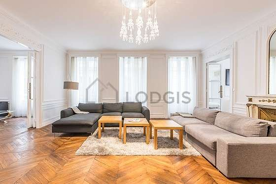 Living room furnished with tv, dvd player, 1 armchair(s)