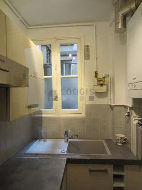 Kitchen with double-glazed windows facing the courtyard