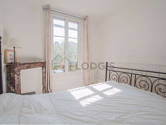 Bedroom with double-glazed windows facing the garden