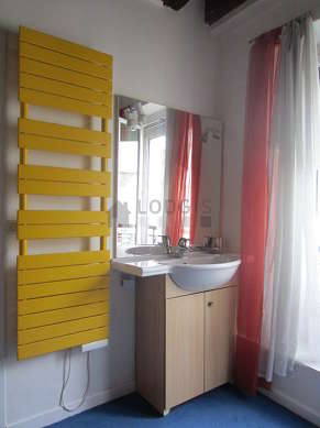Beautiful and bright bathroom with windows and with carpeting floor