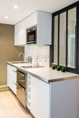 Kitchen where you can have dinner for 2 person(s) equipped with dishwasher, hob, refrigerator, hood