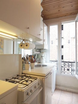 Kitchen equipped with dishwasher, hob, refrigerator, crockery
