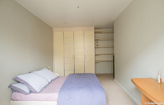Bedroom with double-glazed windows and balcony facing the road