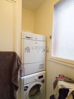 Beautiful laundry room equipped with washing machine, dryer