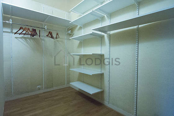 Beautiful dressing-room serviced with : shelves