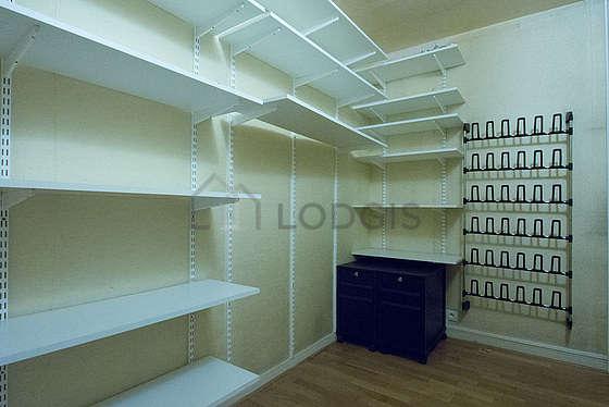 Very quiet walk-in closet with its wooden floor