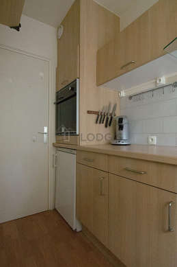Kitchen equipped with dishwasher, hob, freezer, extractor hood