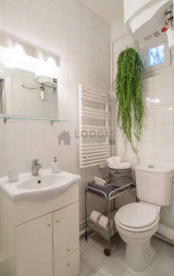 Pleasant bathroom with windows and with tile floor