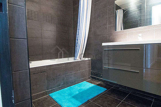 Bathroom equipped with tub, separate shower