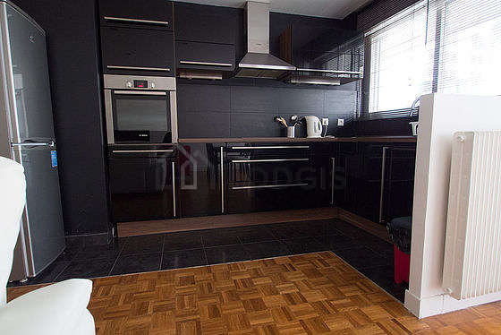 Kitchen with its wooden floor