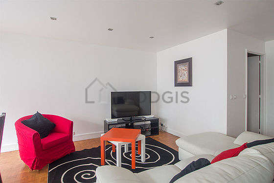 Quiet living room furnished with tv, 4 chair(s)