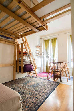 Quiet living room furnished with 1 loft bed(s) of 140cm, 1 sofabed(s) of 140cm, dining table, wardrobe