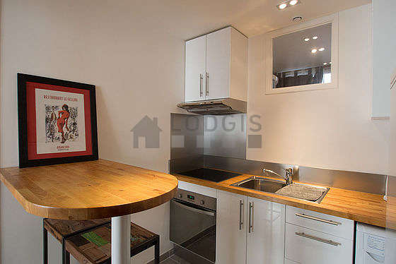 Kitchen where you can have dinner for 2 person(s) equipped with washing machine, dryer, refrigerator, hood