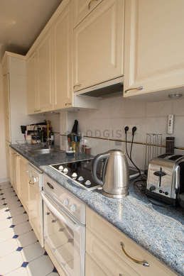 Very bright kitchen with double-glazed windows and balcony facing the courtyard