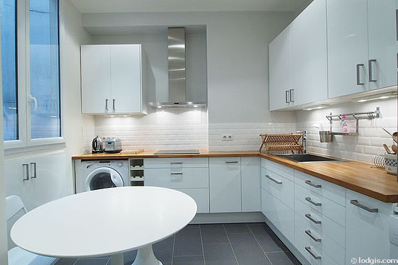 Kitchen where you can have dinner for 3 person(s) equipped with washing machine, refrigerator, hood, cookware