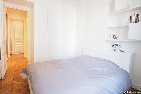 Chambre de 11m² avec du parquet au sol