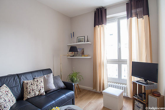 Very bright bedroom equipped with tv, 2 armchair(s)