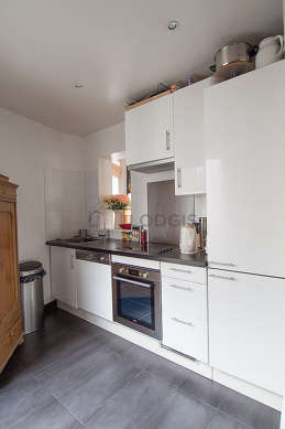Very bright kitchen with double-glazed windows facing the road