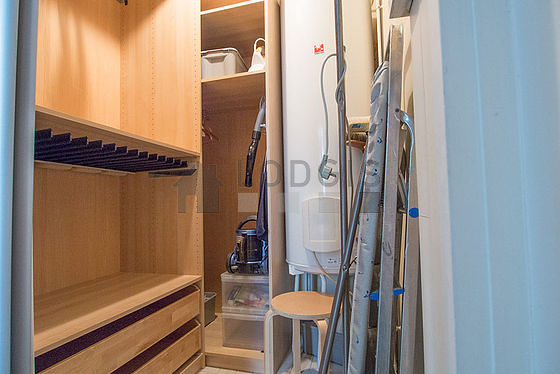Dressing-room serviced with : wardrobe, shelves, stool