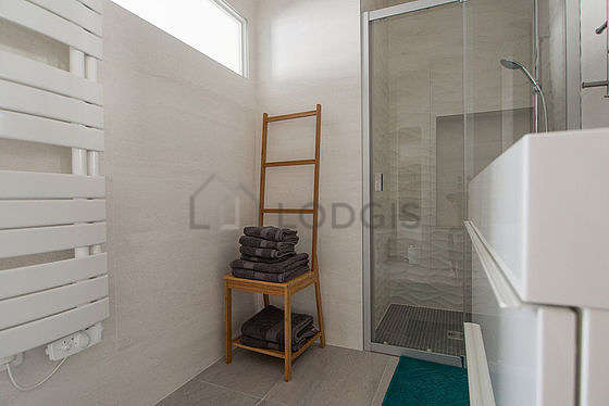 Bathroom equipped with washing machine, dryer, hair-dryer