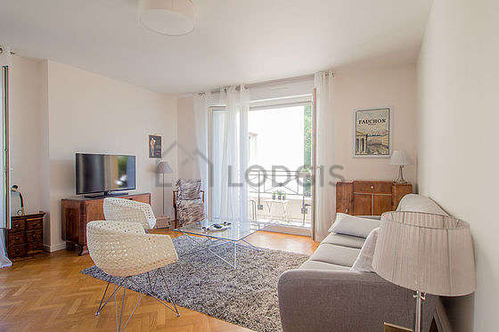 Very quiet living room furnished with tv, 3 armchair(s), 4 chair(s)