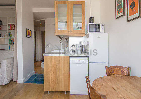 Kitchen where you can have dinner for 4 person(s) equipped with washing machine, dryer, refrigerator, crockery
