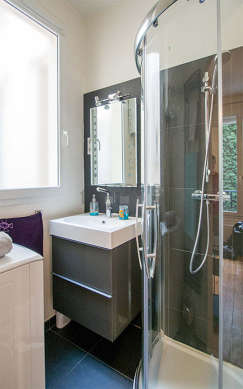 Beautiful and bright bathroom with double-glazed windows and with wooden floor